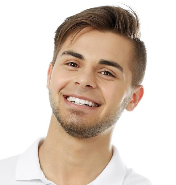 smiling dental patient with bridge